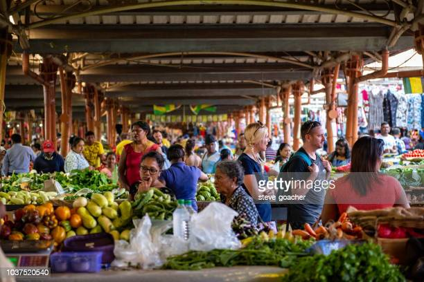 busy covered market place at centre de flacq in mauritius. - mauritius stock photos and pictures