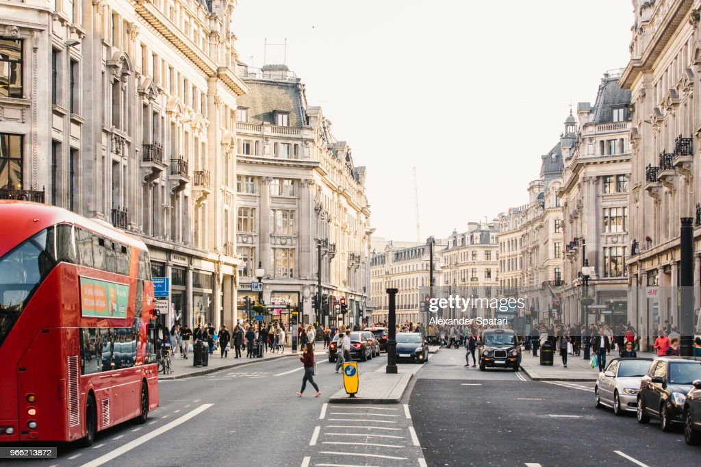 Busy day on Regent street with crowds of people and cars, London, England, UK : Stock Photo