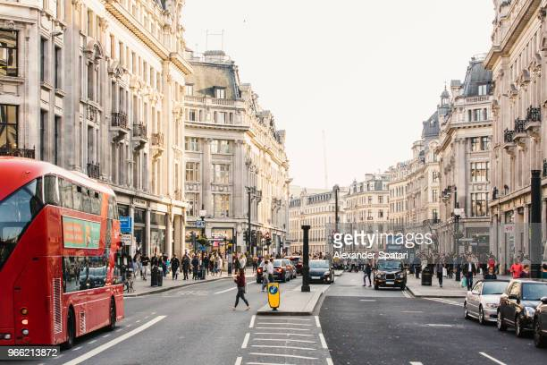 busy day on regent street with crowds of people and cars, london, england, uk - city of westminster london stock pictures, royalty-free photos & images
