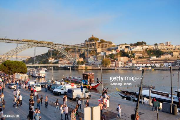 Busy Douro River waterfront in Barrio La Ribeira with view of Gaia area Porto Porto Region Portugal