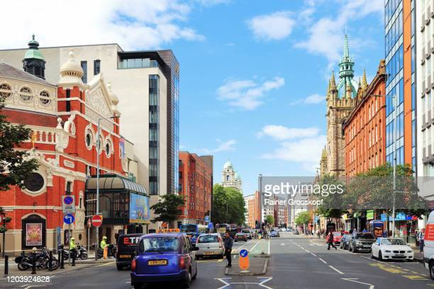 busy downtown street with a theatre and various high-rise buildings in belfast - rainer grosskopf stock pictures, royalty-free photos & images