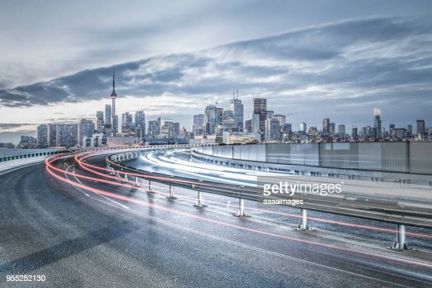 busy dusk traffic of toronto city - toronto stock pictures, royalty-free photos & images