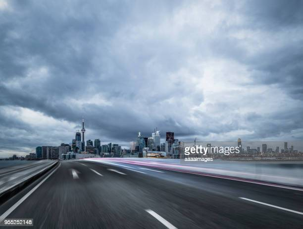 busy dusk traffic of toronto city - 高架道路 ストックフォトと画像