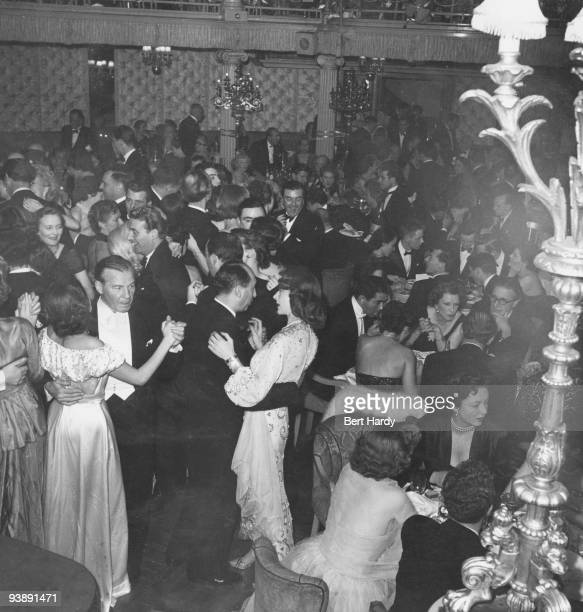 Busy evening at the Cafe de Paris nightclub in London, after a theatre first-night, February 1951. Original publication: Picture Post - 5202 -...