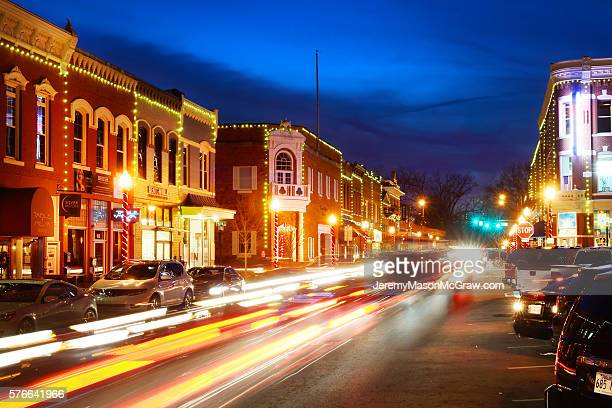 a busy evening in downtown bentonville - bentonville stock photos and pictures