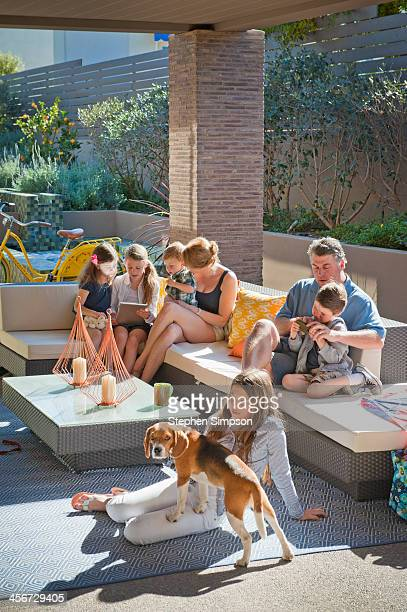 busy family morning on outdoor patio area