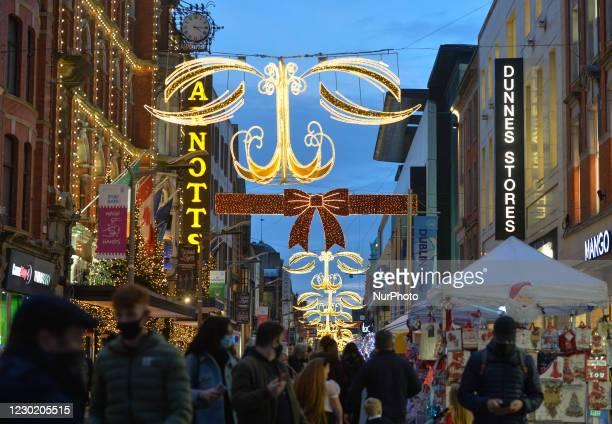Busy Henry Street in Dublin city center. On Friday, December 18 in Dublin, Ireland.