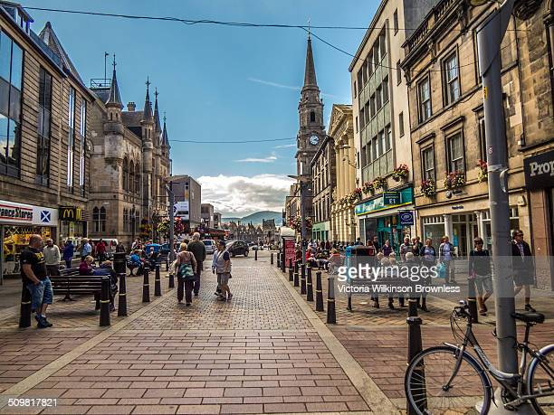 Busy high street filled with shoppers, Inverness, Scotland.
