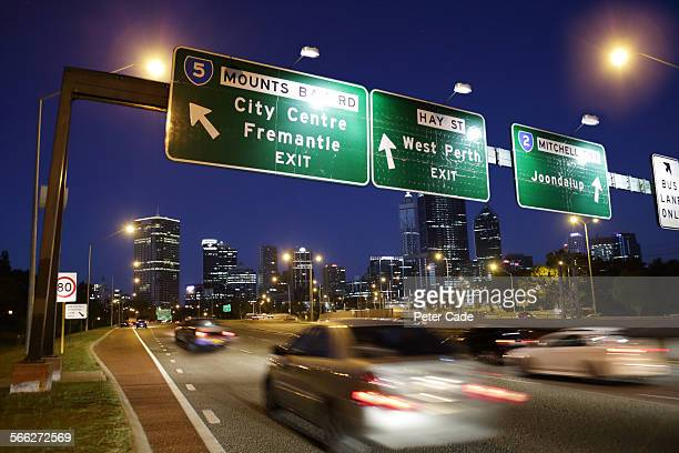 busy highway in city at night , city of perth . - perth australia stock pictures, royalty-free photos & images