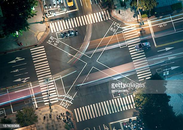 busy junction at night from above - pedestrian crossing stock photos and pictures