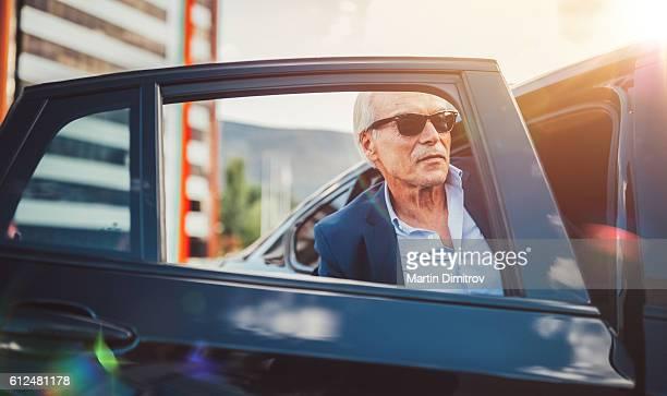 Busy man hailing a taxi