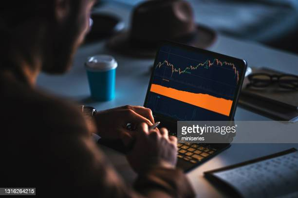 busy man using laptop at workplace - economist stock pictures, royalty-free photos & images