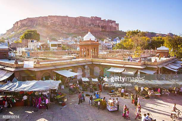 busy market in jodhpur with mehrangarh fort behind - jodhpur stock pictures, royalty-free photos & images