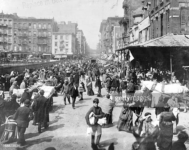 A busy market scene at the lower East Side New York City 1900s