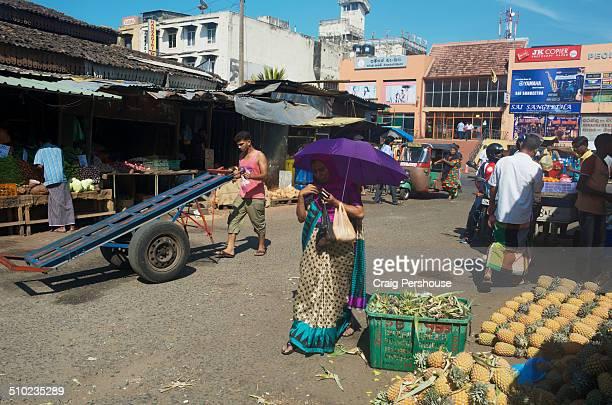 Busy market scene on 5th Cross St.