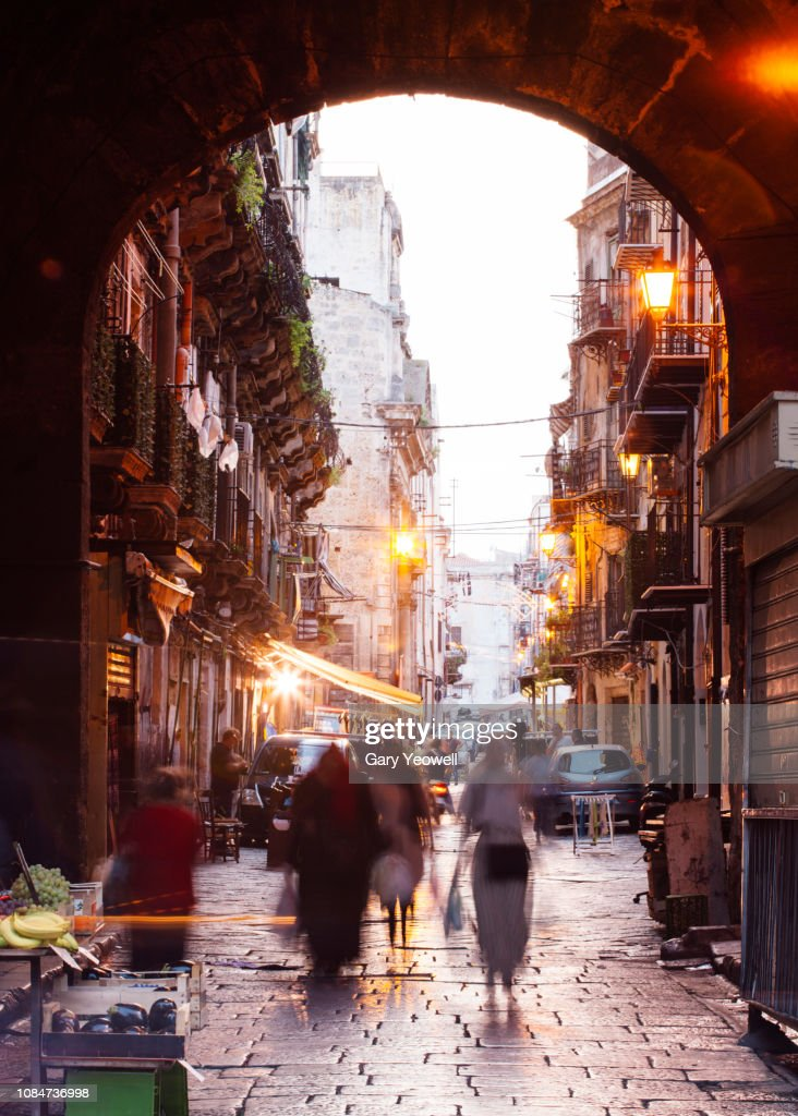 Busy market street and archway in Palermo : Stock Photo