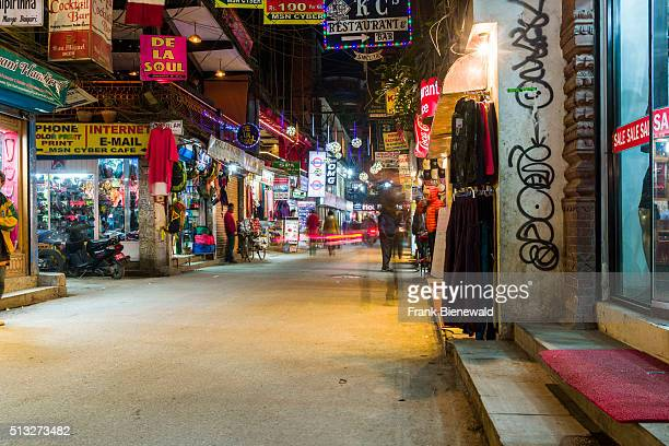 A busy market street in Thamel at night