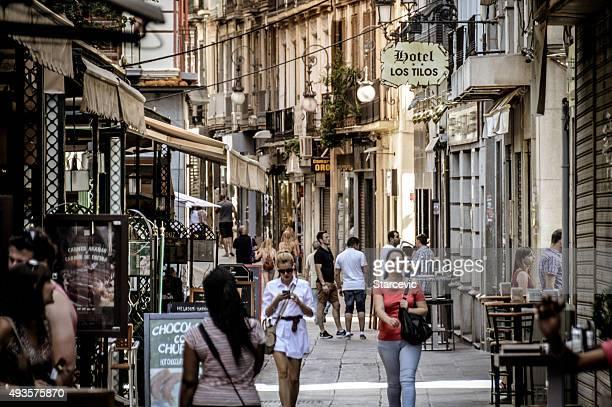 Busy medieval street in Granada, Spain
