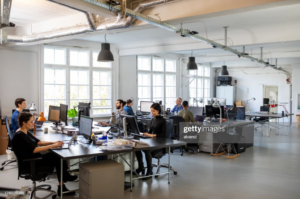 Busy modern open plan office with staff : Stock Photo