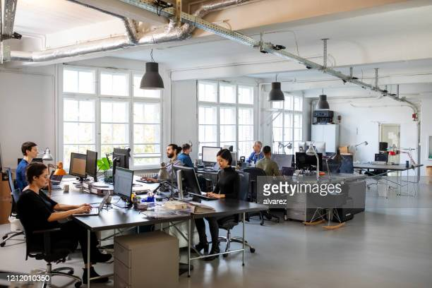 busy modern open plan office with staff - office stock pictures, royalty-free photos & images