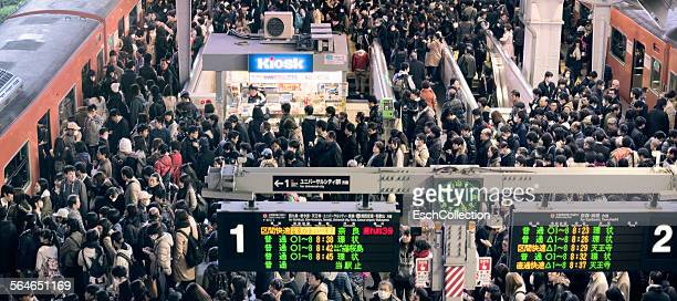 busy morning commute at osaka station, japan - japan commuters ストックフォトと画像