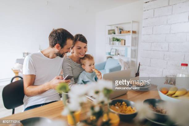 busy mornings together - happy family stock photos and pictures