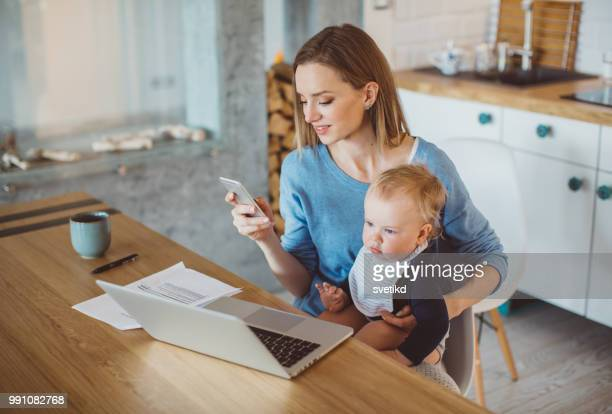busy mother spend morning with son - stay at home mother stock pictures, royalty-free photos & images