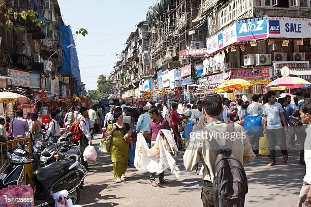 busy mumbai street corner at crawford market - mumbai stock pictures, royalty-free photos & images