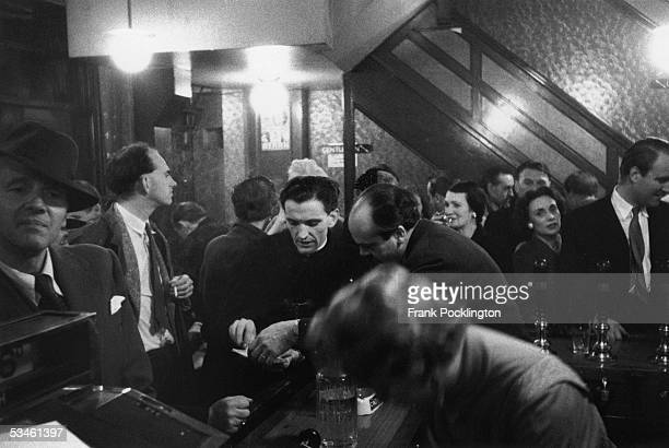 Busy night in the York Minster pub in Dean Street, Soho, London, 22nd October 1955. Original publication: Picture Post - 8106 - A Mission In Soho...