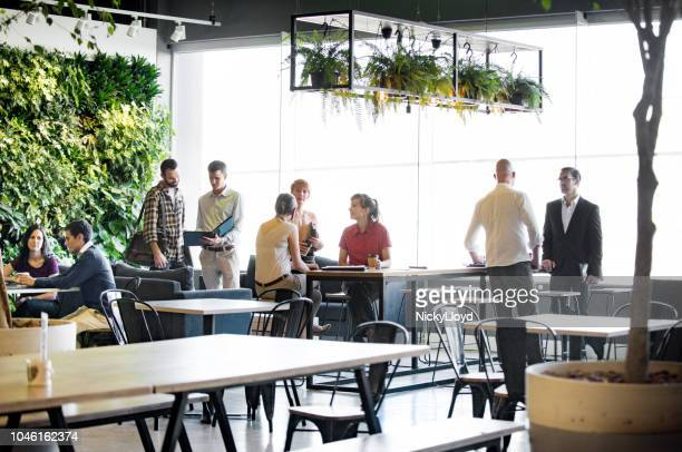 busy office common area - green stock pictures, royalty-free photos & images