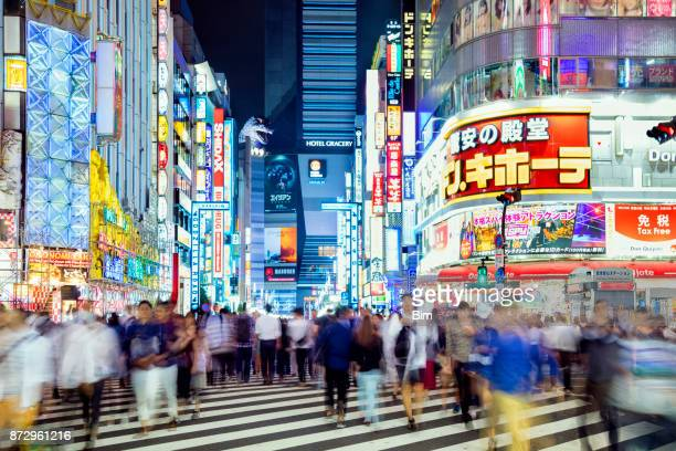 busy pedestrians crossing street in tokyo, japan - kanto region stock photos and pictures
