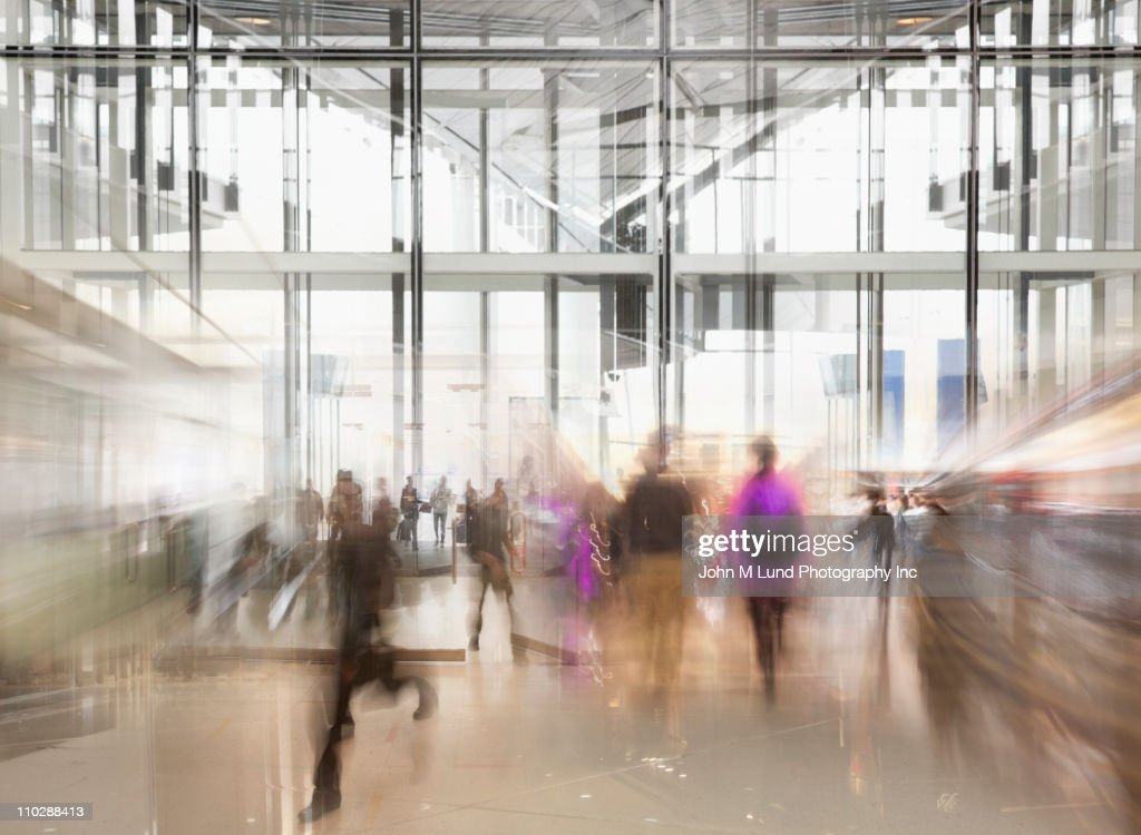 Busy people rushing in lobby : Stock Photo