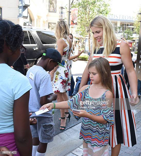 Busy Philipps and daughter Birdie Host Baby2Baby Back To School event at The Grove Los Angeles on August 3 2016 in Los Angeles California