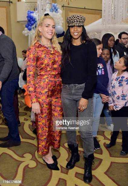 Busy Philipps and Kelly Rowland attend The Baby2Baby Holiday Party Presented By FRAME And Uber at Montage Beverly Hills on December 15, 2019 in...