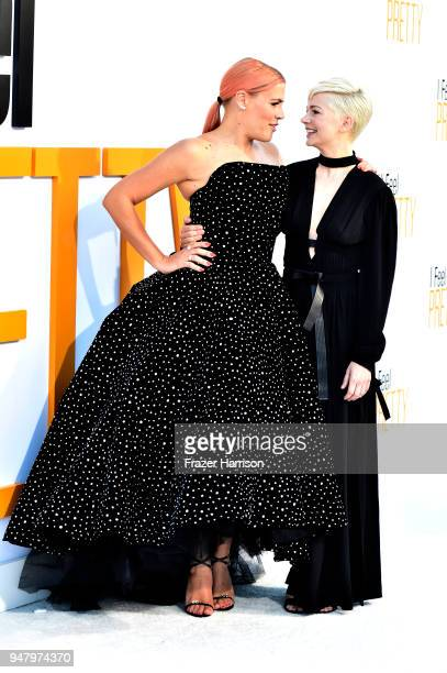 Busy Philipps and Michelle Williams atttend the Premiere Of STX Films' I Feel Pretty at Westwood Village Theatre on April 17 2018 in Westwood...