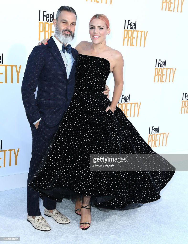 Busy Philipps;Marc Silverstein arrives at the Premiere Of STX Films' 'I Feel Pretty' at Westwood Village Theatre on April 17, 2018 in Westwood, California.