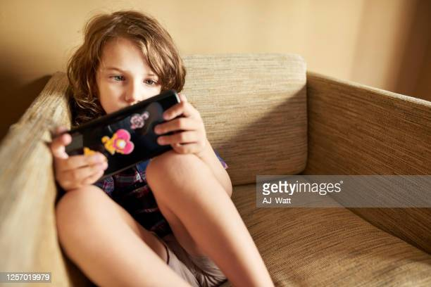 busy playing video game - handheld video game stock pictures, royalty-free photos & images