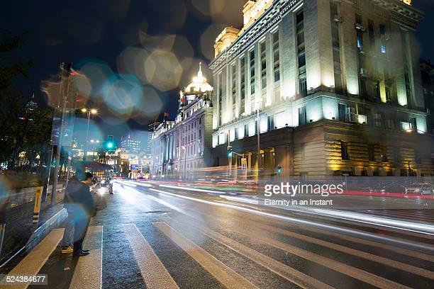Busy, rainy street at night, Shanghai, China