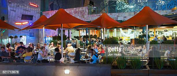Busy restaurant in Federation Square at night