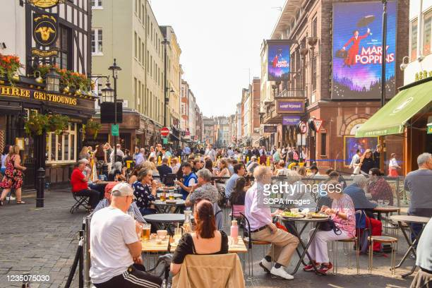 Busy restaurants and cafes are seen in Old Compton Street as temporary al fresco, street seating continues in Soho. Several streets in Central London...