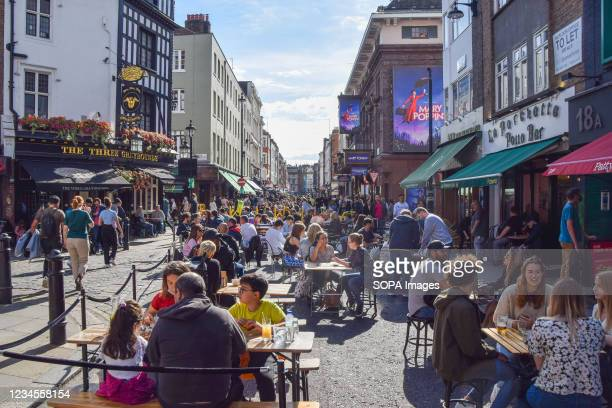 Busy restaurants and cafes in Old Compton Street. Several streets in Soho have been blocked for traffic at certain times to allow outdoor, al fresco...