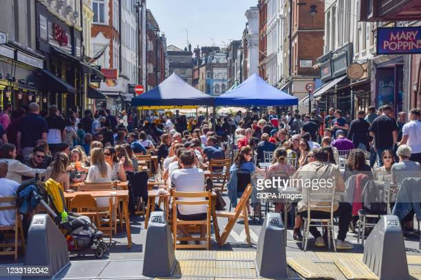 Busy restaurants in Old Compton Street, Soho. Crowds of people flocked to the cafes and restaurants in Central London as temperatures rose over the...