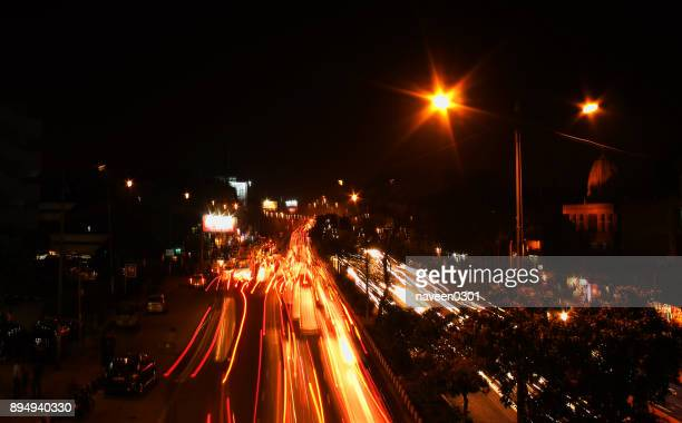 A busy road at night in New Delhi, India
