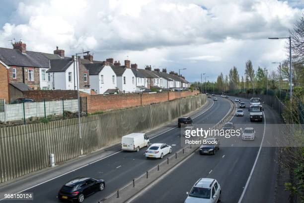 busy road close to houses - close to stock pictures, royalty-free photos & images