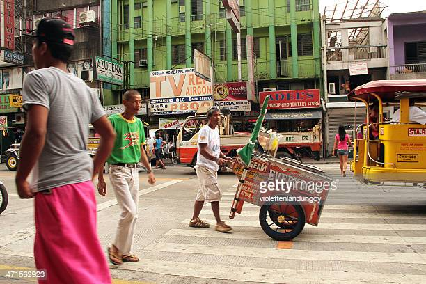 busy road in the city of olongapo - jeepney stock pictures, royalty-free photos & images