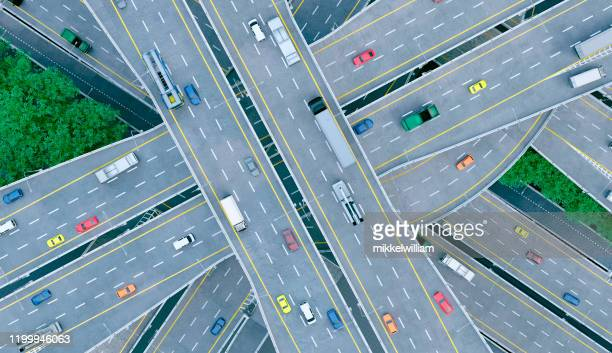 busy roads full of cars and intersections seen from high above - direction stock pictures, royalty-free photos & images