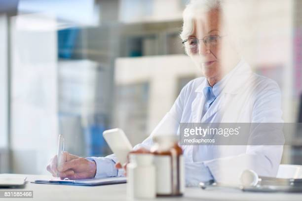 Busy senior doctor