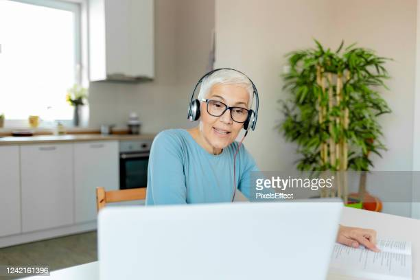 busy senior woman - white hair stock pictures, royalty-free photos & images