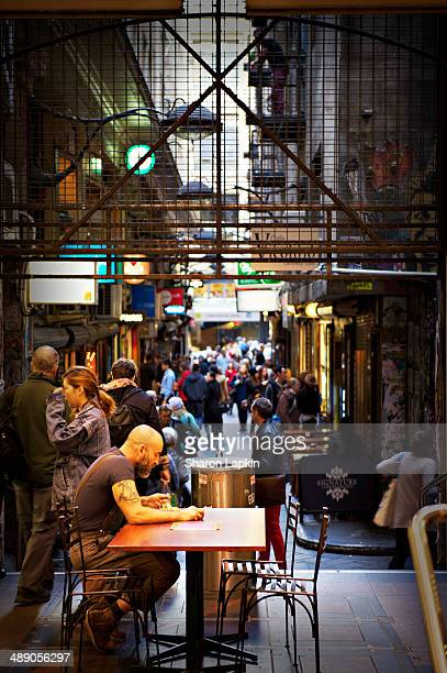 Busy shoppers and workers in a Melbourne arcade