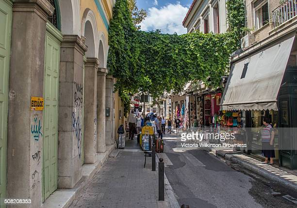 CONTENT] Busy shopping area with shops displaying wares on the street Plaka Central Athens